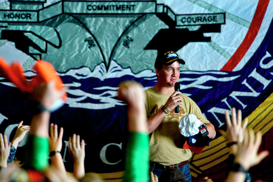 Denver Broncos quarterback Peyton Manning addresses Sailors of the Nimitz-class aircraft carrier USS John C. Stennis (CVN 74) during a USO sponsored visit. (U.S. Navy photo by Mass Communication Specialist 2nd Class Kenneth Abbate) Photo: MC2 (AW/SW) Kenneth Abbate / DIGITAL