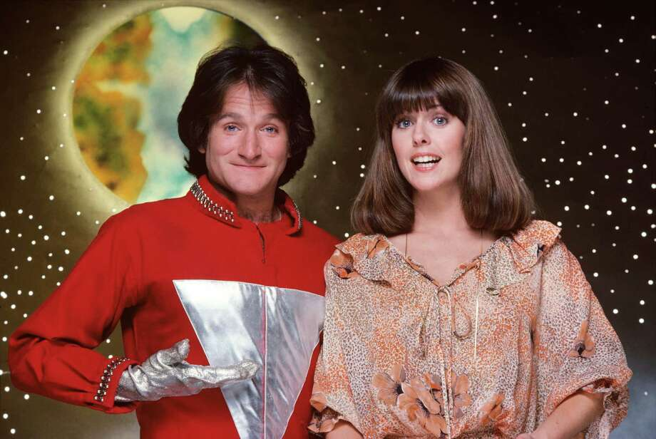 """The character of Mork, an alien from the planet of Ork, became so popular from an episode of """"Happy Days"""" that it was spun-off into this series starring Robin Williams in the lead role (his first major acting break). The misfit alien was sent to study Earthlings by his fellow Orkans. Landing in a giant eggshell, near Boulder, Colorado, he was befriended by Mindy McConnell (Pam Dawber), who helped him adjust to Earth's strange ways.,  (Photo by Jim Britt/ABC via Getty Images) Photo: JIM BRITT, Multiple / ©1978, ABC Photo Archives. All rights reserved. For editorial use only. NO ARCHIVING, NO RESALE."""