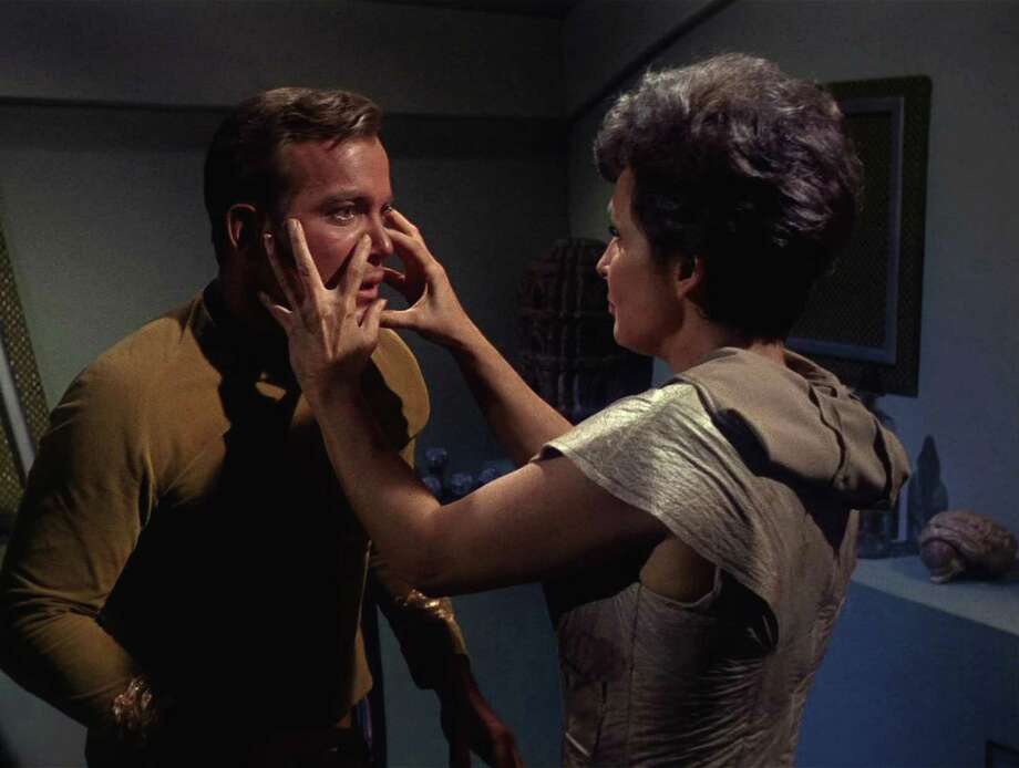 Nancy Crater, played by American actress Jeanne Bal (1928 - 1966), feels the face of Captain James T. Kirk, played by Canadian actor William Shatner in a scene from 'The Man Trap,' the premiere episode of 'Star Trek,' which aired on September 8, 1966. (Photo by CBS Photo Archive/Getty Images) Photo: Frame Grab, Multiple / 2008 CBS WORLDWIDE INC.