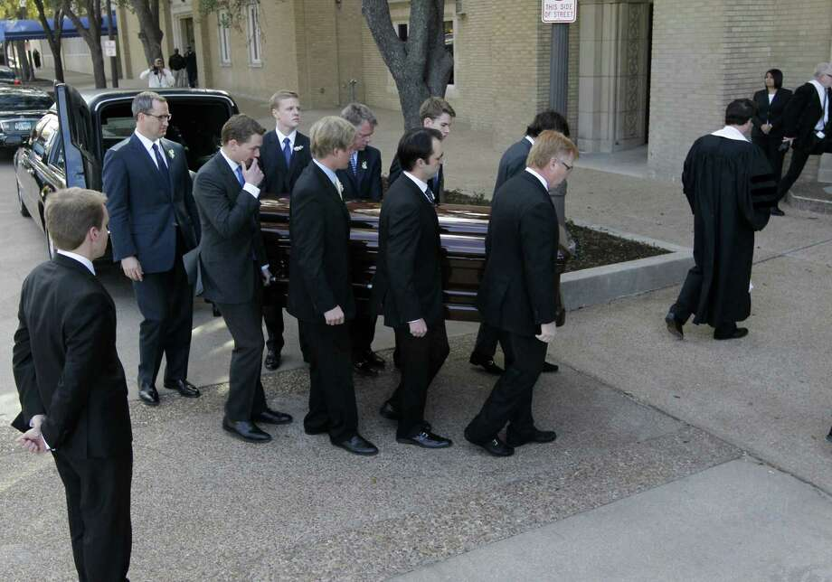 Pallbearers carry Van Cliburn's coffin into Broadway Baptist Church for a funeral service for in Fort Worth, Texas on Sunday, March 3, 2013. The internationally famous musician died this week. About 1,400 people attended a memorial service for Cliburn, who died Wednesday at 78 after fighting bone cancer. As the service began, the Fort Worth Symphony Orchestra accompanied a choir as pall bearers carried his flower-covered coffin into the Fort Worth church. (AP Photo/Star-Telegram, Ron T. Ennis, Pool) Photo: Ron T. Ennis