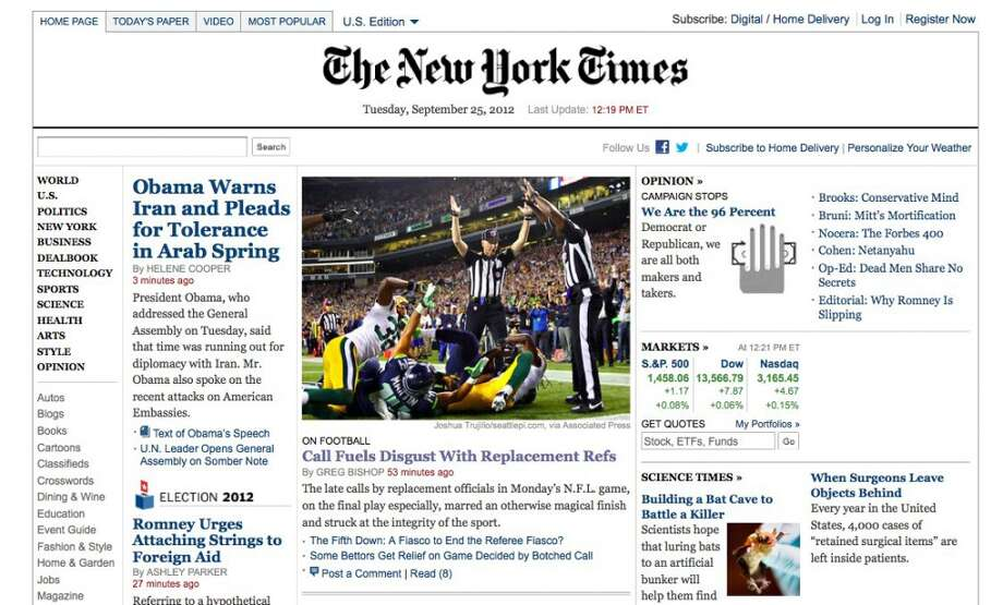 This screenshot shows Lance Easley on the front page of The New York Times website making a controversial call at the end of the Packers-Seahawks 'MNF' game in September 2012. The pressure on Easley was intense immediately after he made the call. The featured photo was taken by seattlepi.com's Joshua Trujillo.