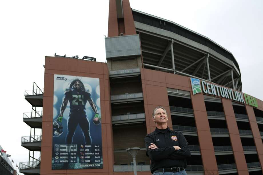 Former NFL replacement official Lance Easley poses near CenturyLink Field on Friday, during his first trip back to Seattle since the fateful 'Monday Night Football' game.