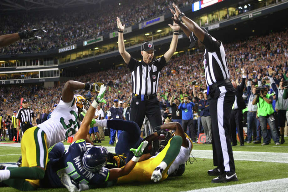 20 of the most controversial calls in sportsThere has been a lot of debate over the Seahawks' game-winning touchdown Sept. 24 over the Packers. Most sports pundits agreed that the replacement officials blew the call, when side judge Lance Easley (pictured at center) ruled that Seattle receiver Golden Tate and Green Bay safety M.D. Jennings simultaneously caught the ball, awarding Seattle the last-second touchdown. The replay, many people argued, showed something different -- that Jennings intercepted QB Russell Wilson's Hail Mary pass. The NFL later said Tate should have been called for offensive pass interference he shoved Packers safety Sam Shield to the ground before jumping up for the ball.The football world still hasn't forgotten about that controversial call. Let's take a look at 20 of the worst calls in sports history -- including several involving local teams. Photo: JOSHUA TRUJILLO / SEATTLEPI.COM