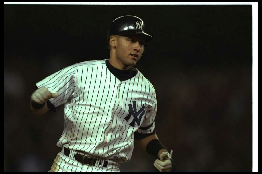 Oct. 9, 1996 -- Fan helps Derek Jeter hit home runIn Game 1 of the 1996 American League Championship Series between the Yankees and Orioles, his team trailing 4-3 in the bottom of the eighth inning, New York's Derek Jeter (pictured) hit a deep fly ball to left field. A 12-year-old fan, Jeff Maier, reached in from the stands and deflected Jeter's ball over the fence. Though spectator interference should have been called, umpire Rich Garcia didn't see it and ruled a home run, tying the game at 4-4. New York's Bernie Williams then hit a walk-off homer in the 11th inning to win the game for the Yankees. Photo: Al Bello, Getty Images / Getty Images North America