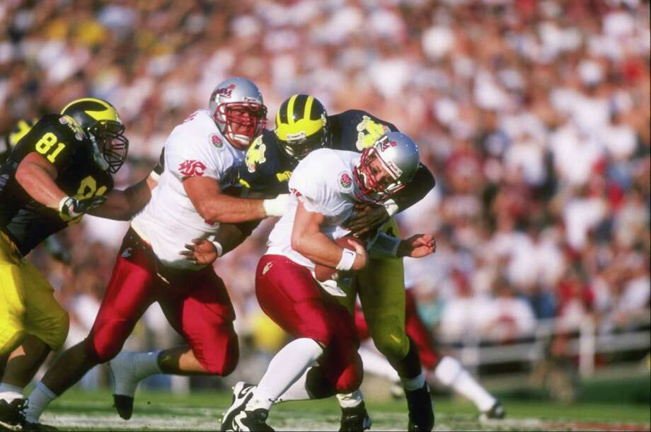 Jan. 1, 1998 -- Two seconds remain in the Rose BowlWSU Cougars fans know that there are still two seconds left in the 1998 Rose Bowl. Trailing 21-16 with just seconds left in the game, Washington State quarterback Ryan Leaf was leading the Cougars down field and, after the game clock stopped at 2 seconds as the officials moved the first-down chains, attempted to spike the ball at the Michigan 16-yard line to give WSU one last play. Leaf appeared to spike it with 1 second left in the game, but the officials ruled the game was over. Michigan won 21-16 and Cougars fans are still bitter. Photo: Jed Jacobsohn, Getty Images / Getty Images North America