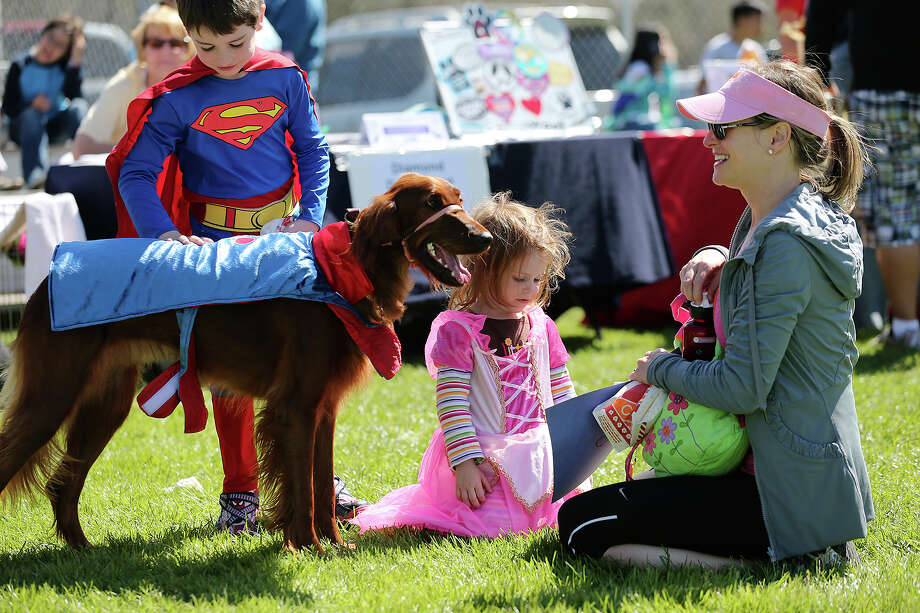 The Siegal familly from left, Jack, Ella, Nancy and their dog, Charlotte, participate in the 5th annual Purim Pet Parade at the Barshop Jewish Community Center, Sunday, March 3, 2013. Proceeds from the event benefitted the National Council of Jewish Women and the San Antonio Humane Society. Photo: Jerry Lara, San Antonio Express-News / ©2013 San Antonio Express-News