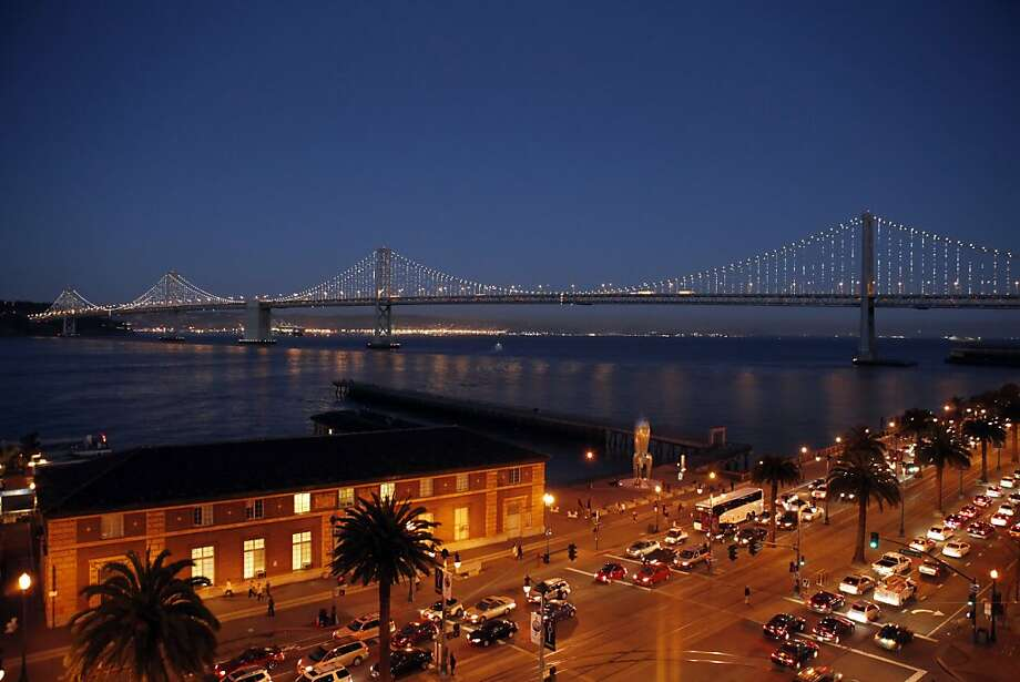 Most of the 25,000 LED lights illuminating the cables on the Bay Bridge work fine, but hundreds are causing trouble. Photo: Carlos Avila Gonzalez, The Chronicle