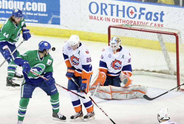 Bridgeport Sound Tigers defenseman Jordan Hill (25) blocks a shot in the second period against the Connecticut Whale on Sunday, March 3, 2013. Photo: Unknown, B.K. Angeletti / Connecticut Post freelance B.K. Angeletti