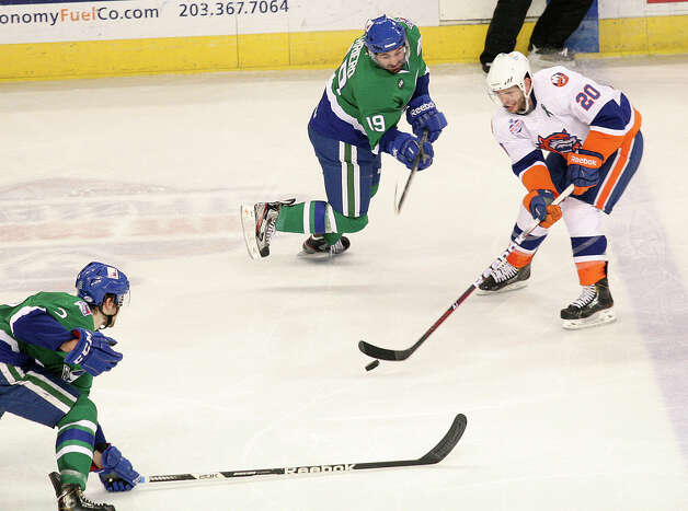 Bridgeport Sound Tigers Blair Riley (20) takes a shot in the second period against the Connecticut Whale on Sunday, March 3, 2013. Photo: Unknown, B.K. Angeletti / Connecticut Post freelance B.K. Angeletti