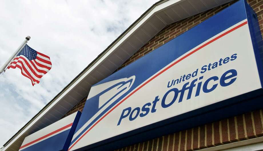The US Post Office  in Bristow, Virginia, is seen in this August 5, 2009 file photo. The New York Times reported on September 5, 2011 that the US Postal Service may have to shut down completely if Congress does not take emergency action to stabilize its finances.  AFP Photo/Paul J. Richards / FILES (Photo credit should read PAUL J. RICHARDS/AFP/Getty Images) Photo: PAUL J. RICHARDS / AFP