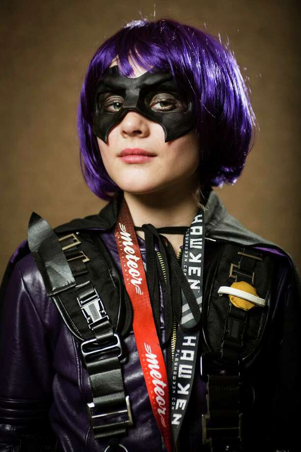 "Anna Utley, dressed as ""Hitgirl,"" poses for a portrait on the third day of the annual Emerald City Comicon on Sunday, March 3, 2013, in the Washington State Convention Center in Seattle, Wash. Photo: JORDAN STEAD / SEATTLEPI.COM"