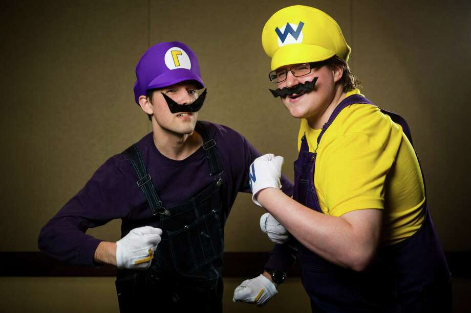 "David Coxch, left, dressed as ""Waluigi"" and Nathaniel Clack, dressed as ""Wario,"" pose for a portrait on the third day of the annual Emerald City Comicon on Sunday, March 3, 2013, in the Washington State Convention Center in Seattle, Wash. Photo: JORDAN STEAD / SEATTLEPI.COM"
