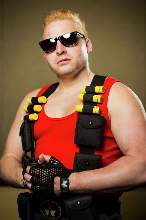 "Grey Liascos, dressed as ""Duke Nukem,"" poses for a portrait on the third day of the annual Emerald City Comicon on Sunday, March 3, 2013, in the Washington State Convention Center in Seattle, Wash. Photo: JORDAN STEAD / SEATTLEPI.COM"
