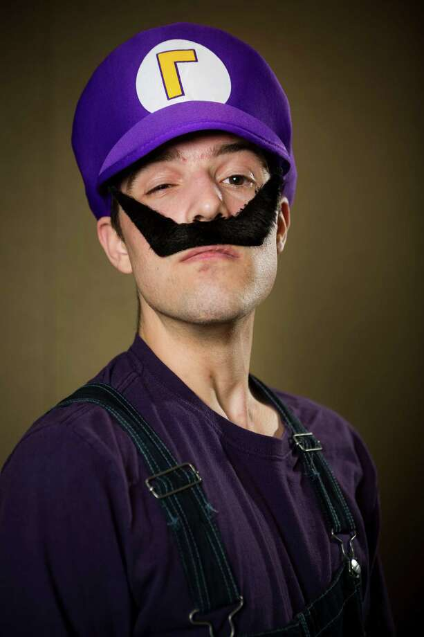 "David Coxch, dressed as ""Waluigi,"" poses for a portrait on the third day of the annual Emerald City Comicon on Sunday, March 3, 2013, in the Washington State Convention Center in Seattle, Wash. Photo: JORDAN STEAD / SEATTLEPI.COM"