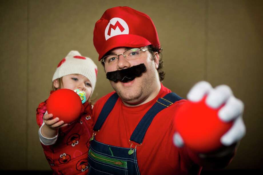 "Mike Stoumbos, right, dressed as ""Mario"" and Mira Cooper, left, dressed as ""Toad,"" pose for a portrait on the third day of the annual Emerald City Comicon on Sunday, March 3, 2013, in the Washington State Convention Center in Seattle, Wash. Photo: JORDAN STEAD / SEATTLEPI.COM"