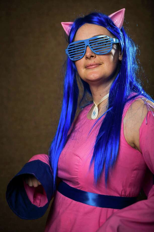 "Kristin Harbuck, dressed as ""Firefly"" from My Little Pony, poses for a portrait on the third day of the annual Emerald City Comicon on Sunday, March 3, 2013, in the Washington State Convention Center in Seattle, Wash. Photo: JORDAN STEAD / SEATTLEPI.COM"
