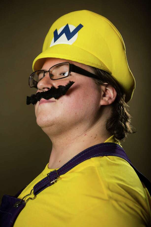 "Nathaniel Clack, dressed as ""Wario,"" poses for a portrait on the third day of the annual Emerald City Comicon on Sunday, March 3, 2013, in the Washington State Convention Center in Seattle, Wash. Photo: JORDAN STEAD / SEATTLEPI.COM"