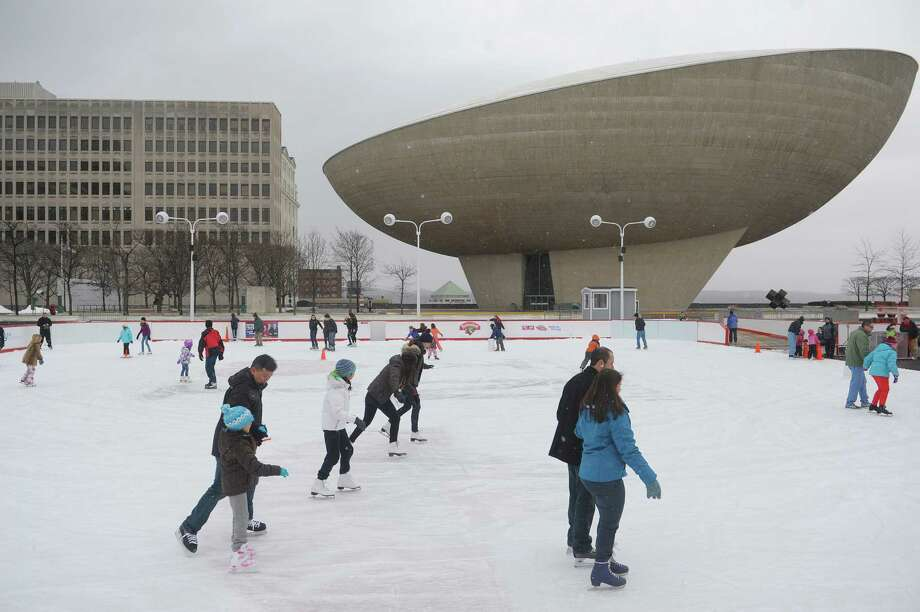 Adults and children skate on the ice skating rink at the Empire State Plaza on Sunday, March 3, 2013 in Albany, NY.  Sunday was the final day the skating rink would be open this season.  (Paul Buckowski / Times Union) Photo: Paul Buckowski