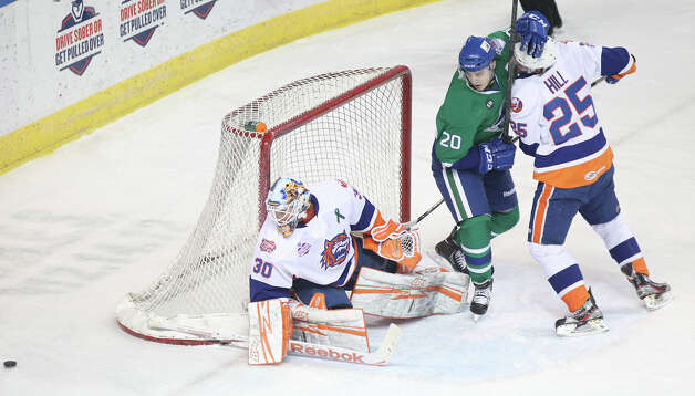 Bridgeport Sound Tigers goalie Kenny Reiter (30) makes a save in the first period against the Connecticut Whale on Sunday, March 3, 2013. Photo: Unknown, B.K. Angeletti / Connecticut Post freelance B.K. Angeletti