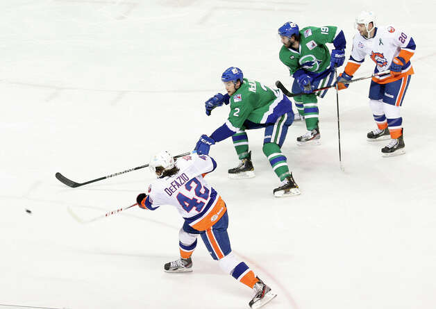 Bridgeport Sound Tigers Brandon DeFazio (42) takes a shot in the second period against the Connecticut Whale on Sunday, March 3, 2013. Photo: Unknown, B.K. Angeletti / Connecticut Post freelance B.K. Angeletti