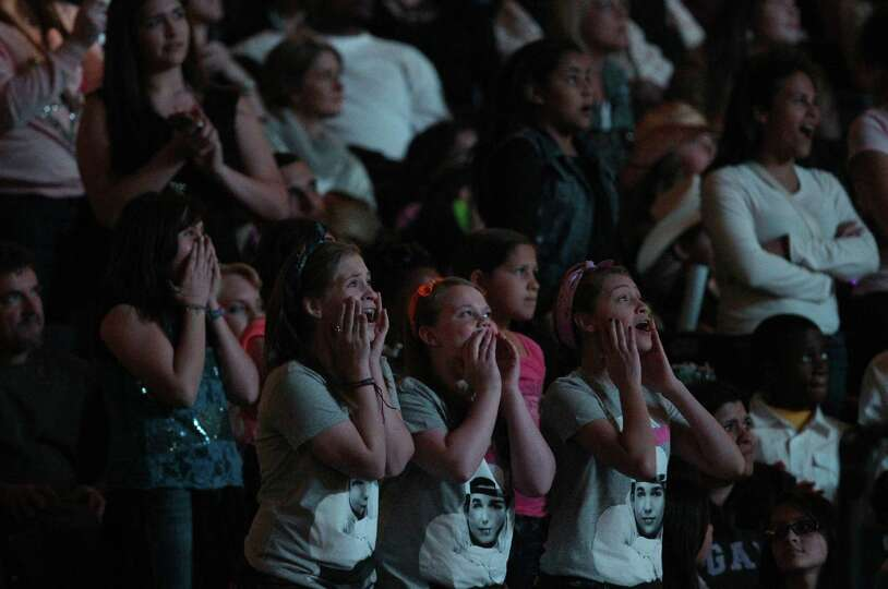 Austin Mahone fans scream during his performance at the Houston Livestock Show and Rodeo at Reliant