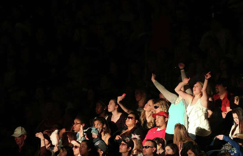 Austin Mahone fans dance during the performance at the Houston Livestock Show and Rodeo at Reliant S