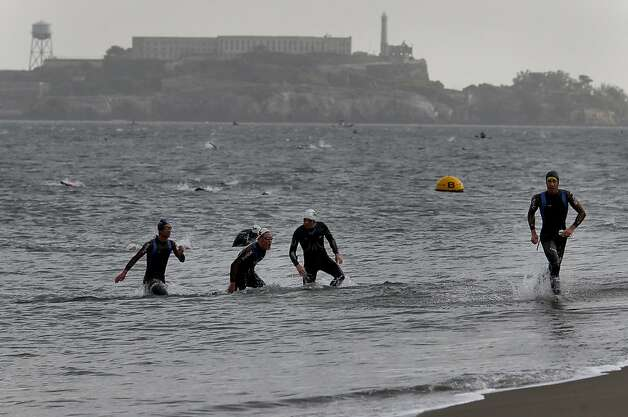 Triathletes were anxious to get to the beach with such chilly bay temperatures and currents. The annual Escape from Alcatraz triathlon was held early Sunday morning March 3, 2013 beginning with a swim in the bay and ending with an eight mile run to the finish line at the Marina Green. Photo: Brant Ward, The Chronicle