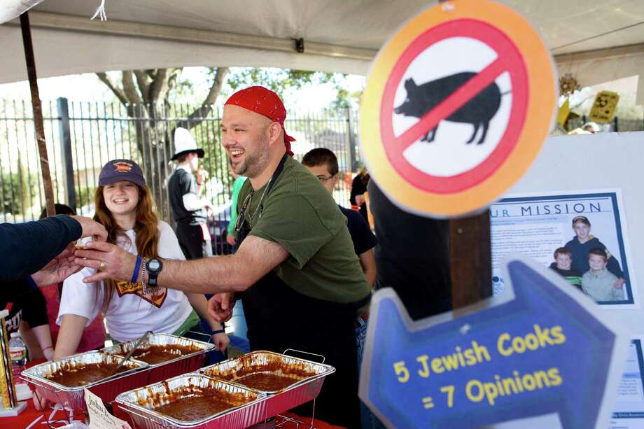 Zoe Freedkin, left, and Joe Buchanan serve chili samples from the Congregation Shaar Hashalon booth during the 3rd Annual Houston Kosher Chili Cookoff Sunday, March 3, 2013, in Houston. Proceeds from the event benefit a number of non-profit organizations in the Houston Jewish community. Photo: Brett Coomer, Houston Chronicle / © 2013 Houston Chronicle