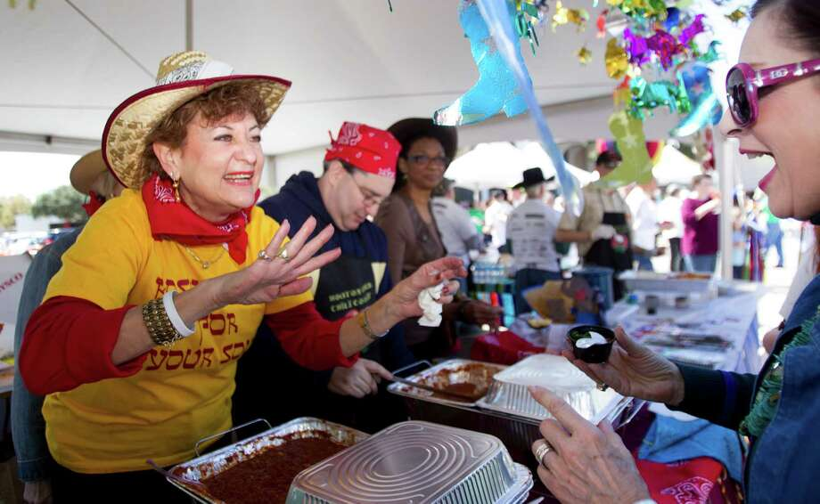 Jane Shapiro, left, serves up a sample of chili during the 3rd Annual Houston Kosher Chili Cookoff Sunday, March 3, 2013, in Houston. Proceeds from the event benefit a number of non-profit organizations in the Houston Jewish community. Photo: Brett Coomer, Houston Chronicle / © 2013 Houston Chronicle