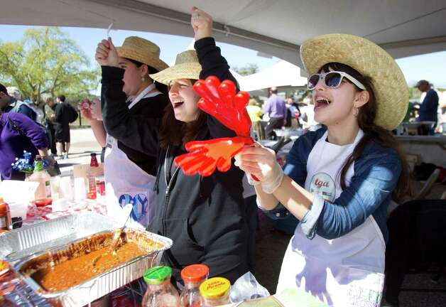 Faige Grossman, left, and Ahuba Grossman cheer while serving chili at the Torah Girls Academy booth during the 3rd Annual Houston Kosher Chili Cookoff Sunday, March 3, 2013, in Houston. Proceeds from the event benefit a number of non-profit organizations in the Houston Jewish community. Photo: Brett Coomer, Houston Chronicle / © 2013 Houston Chronicle