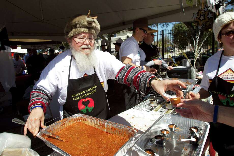 Larry Ellard serves up a sample of chili from the Hebrew Free Loan Society booth during the 3rd Annual Houston Kosher Chili Cookoff Sunday, March 3, 2013, in Houston. Proceeds from the event benefit a number of non-profit organizations in the Houston Jewish community. Photo: Brett Coomer, Houston Chronicle / © 2013 Houston Chronicle