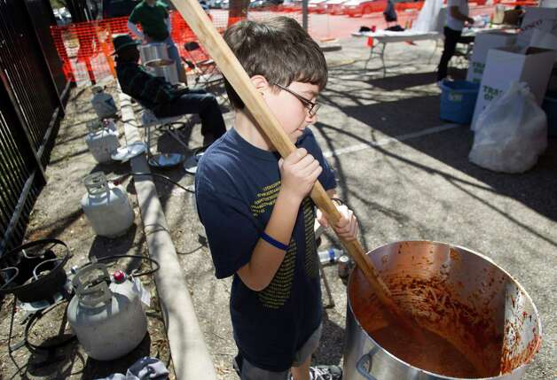 Mason Freeman stirs a pot of chili during the 3rd Annual Houston Kosher Chili Cookoff Sunday, March 3, 2013, in Houston. Proceeds from the event benefit a number of non-profit organizations in the Houston Jewish community. Photo: Brett Coomer, Houston Chronicle / © 2013 Houston Chronicle