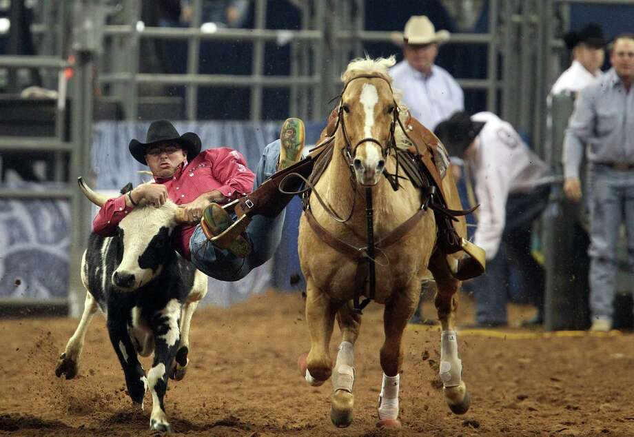 Matt Reeves competes in the BP Super Series III Round 1 Steer Wrestling competition during Houston Livestock Show and Rodeo at Reliant Stadium on Sunday, March 3, 2013, in Houston. Photo: Mayra Beltran, Houston Chronicle / © 2013 Houston Chronicle