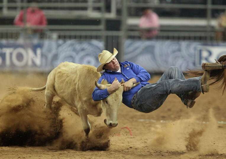 Kody Woodward competes in the BP Super Series III Round 1 Steer Wrestling competition during Houston