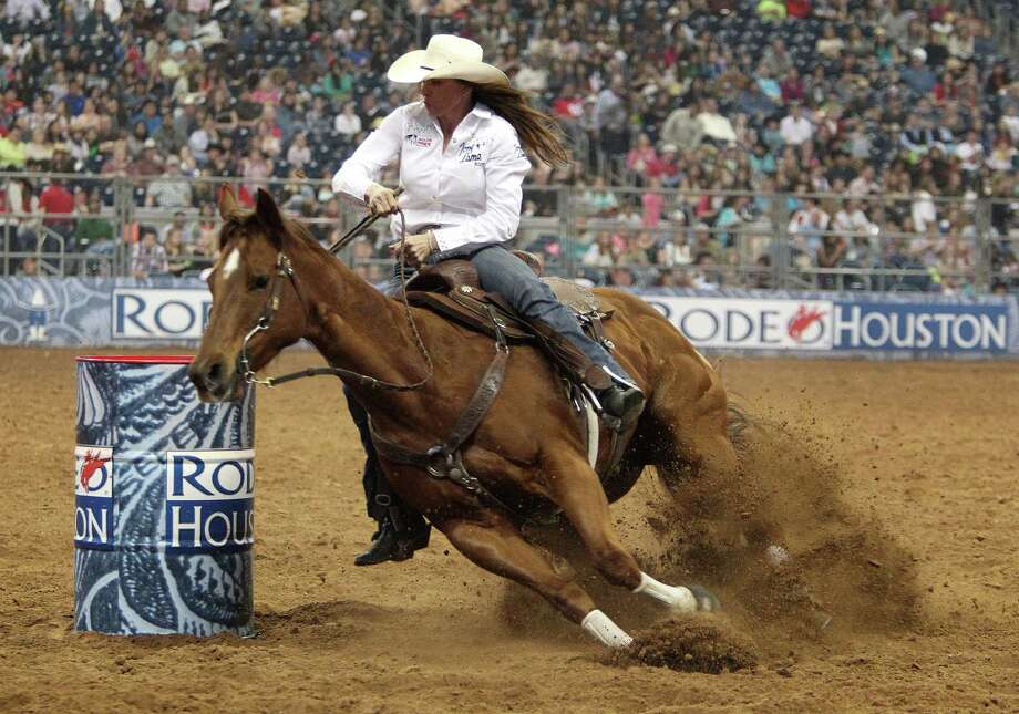 Kelli Tolbert competes in the BP Super Series III Round 1 Barrel Racing competition during Houston Livestock Show and Rodeo at Reliant Stadium on Sunday, March 3, 2013, in Houston. Photo: Mayra Beltran, Houston Chronicle / © 2013 Houston Chronicle