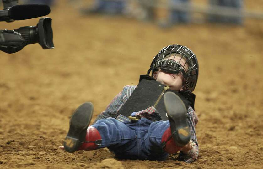 Cullen Devine, of Richmond, doesn't cry after wiping out in the Mutton Bustin' in the Houston Livest
