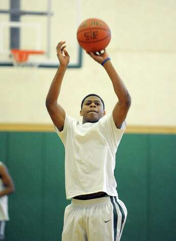 Green Tech High School's Najee Ward takes a jump shot during practice at the school on Sunday, March 3, 2013 in Albany, NY.    (Paul Buckowski / Times Union) Photo: Paul Buckowski
