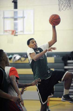 Green Tech High School's Ramion Burt drives to the basket during practice at the school on Sunday, March 3, 2013 in Albany, NY.    (Paul Buckowski / Times Union) Photo: Paul Buckowski