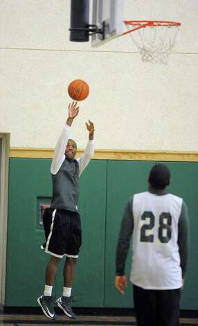 Green Tech High School's Maurice West takes a shot from the corner during practice at the school on Sunday, March 3, 2013 in Albany, NY.    (Paul Buckowski / Times Union) Photo: Paul Buckowski