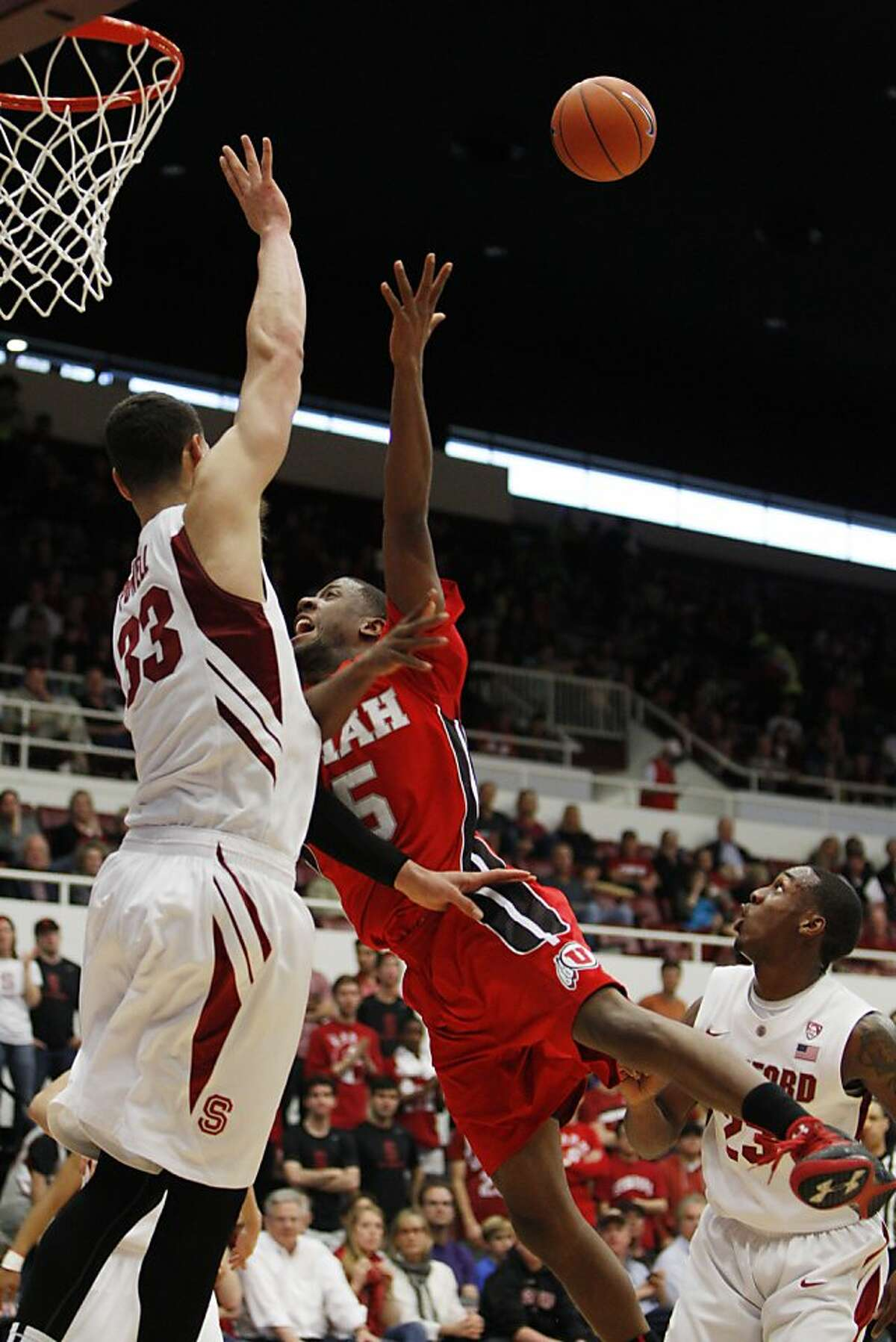 Dwight Powell, left, and Gabriel Harris, right, defend against Utah's Jarred DuBois in the first half. The Stanford Cardinal played the Utah Utes at Maples Pavilion in Stanford, Calif, on Sunday, March 3, 2013, defeating the Utes 84-66.