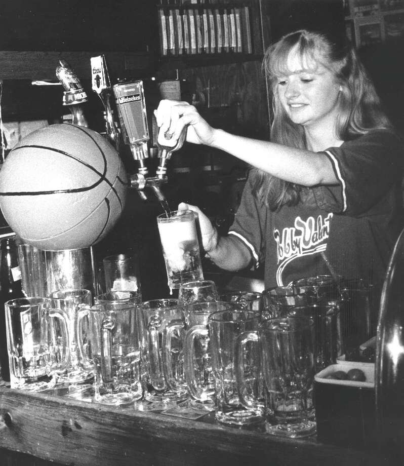 Annette Ammentorp, 19, works her last shift at Bobby Valentine's Sports Gallery Cafe on March 6, 1988, after winning $3.5 million in the state lottery. Photo: Advocate