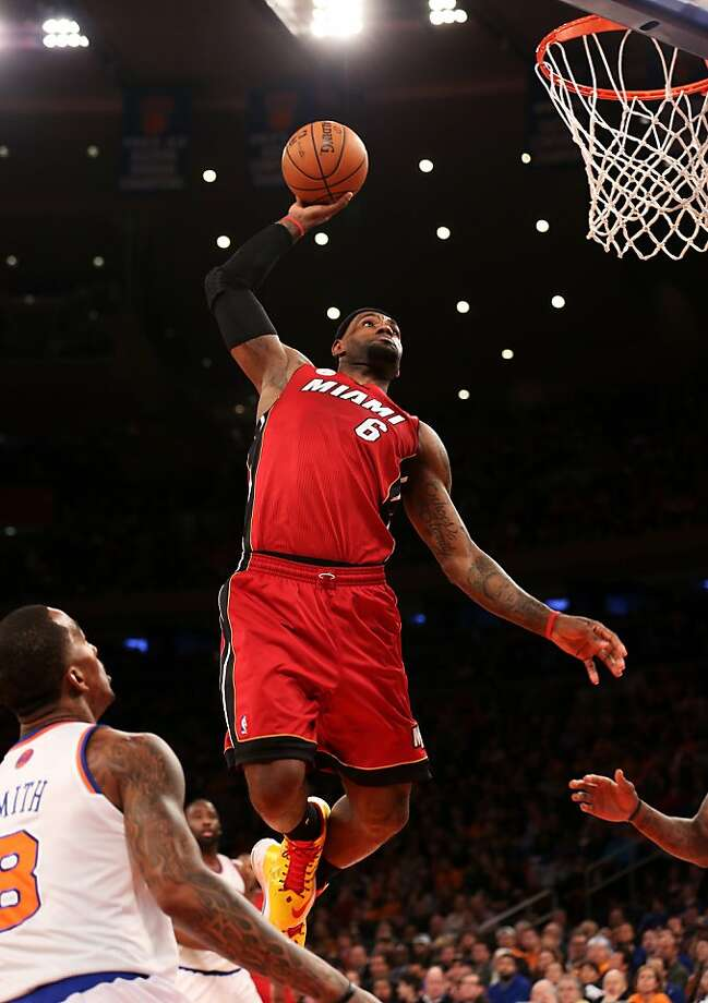 LeBron James throws down a dunk for two of his 29 points against the Knicks. Photo: Nick Laham, Getty Images