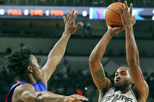 Spurs' Kawhi Leonard shoots around Pistons' Stanley Johnson during first half action Sunday Oct. 18, 2015 at the AT&T Center.