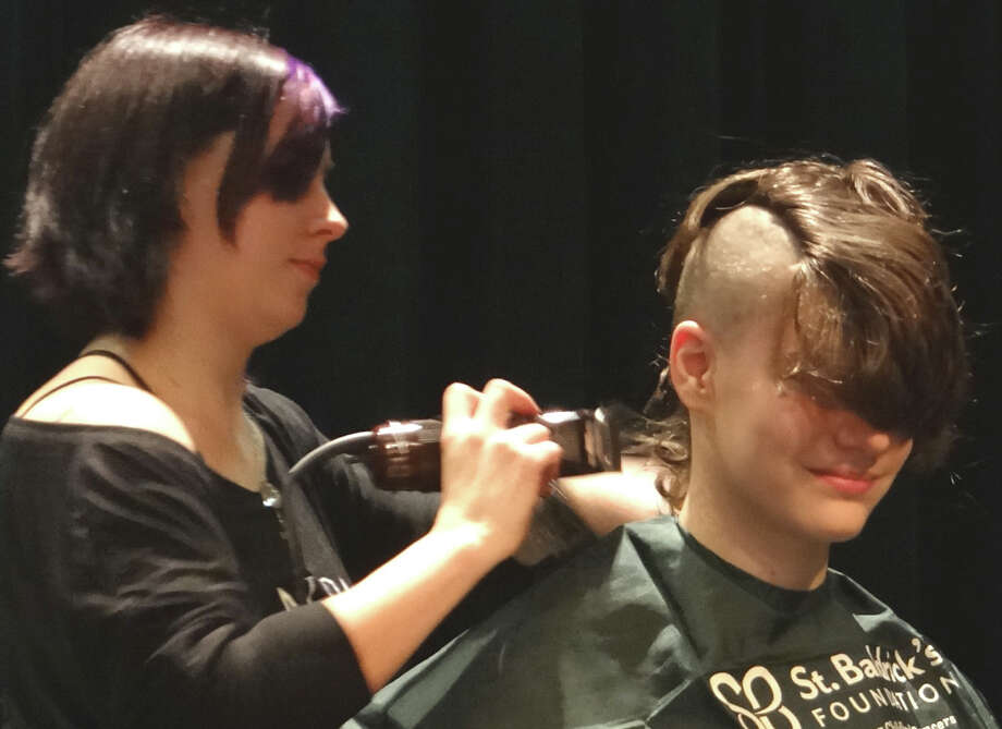 Sam Mahler, 15, of Fairfield, the first young person inducted Sunday as a Knight of the Bald Table, gets his head shaved at Team Brent's St. Baldrick's Day event.  FAIRFIELD CITIZEN, CT 3/3/13 Photo: Mike Lauterborn / Fairfield Citizen contributed