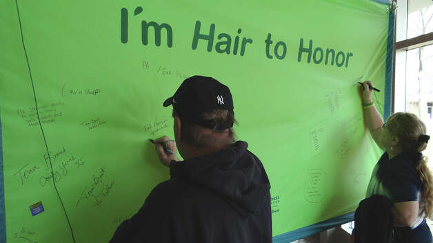 A Hair to Honor wall was set up in the lobby at Fairfield Warde High School on Sunday for people to recognize loved ones fighting cancer. FAIRFIELD CITIZEN, CT 3/3/13 Photo: Mike Lauterborn / Fairfield Citizen contributed