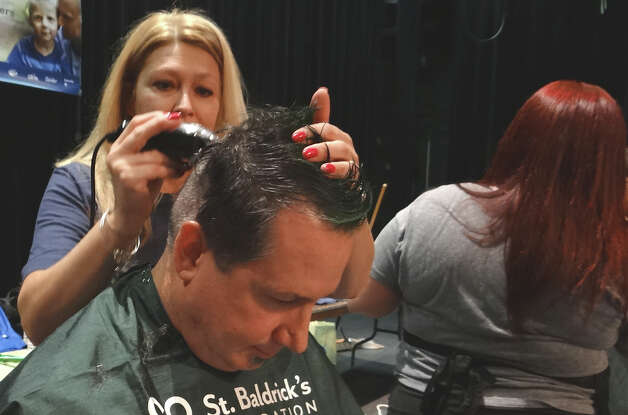 Todd Goodfellow of Fairfield gets buzzed at Sundat's Team Brent St. Baldrick's Day cancer charity fundraiser.  FAIRFIELD CITIZEN, CT 3/3/13 Photo: Mike Lauterborn / Fairfield Citizen contributed