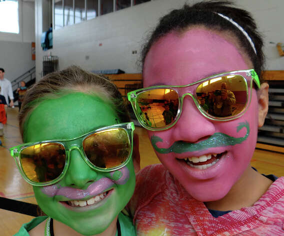 Madi McCreesh, 12, and Grace Ludlow, 11, of Fairfield had their faces painted at the Team Brent St. Baldrick's Day fundraiser Sunday.  FAIRFIELD CITIZEN, CT 3/3/13 Photo: Mike Lauterborn / Fairfield Citizen contributed