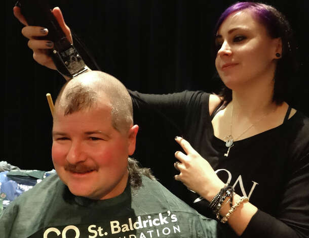 Assistant Fire Chief Scott Bisson gets his head shaved Sunday at Team Brent's St. Baldrick's Day event at Fairfield Warde High School.  FAIRFIELD CITIZEn, CT 3/3/13 Photo: Mike Lauterborn / Fairfield Citizen contributed