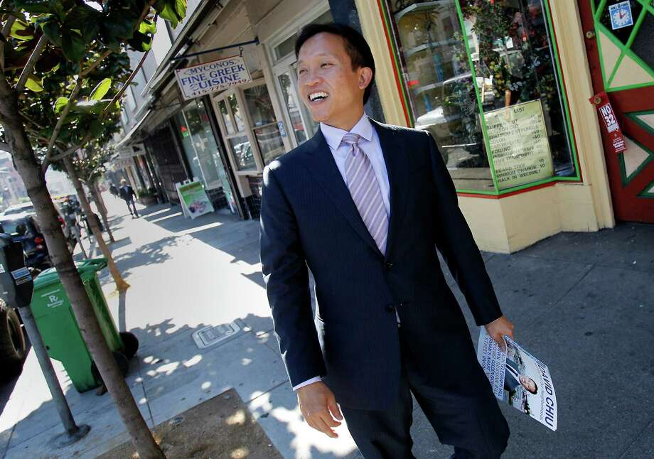 Supervisor David Chiu smiles as a pedestrian recognizes him on Polk Street. Photo: Brant Ward / The Chronicle / ONLINE_YES