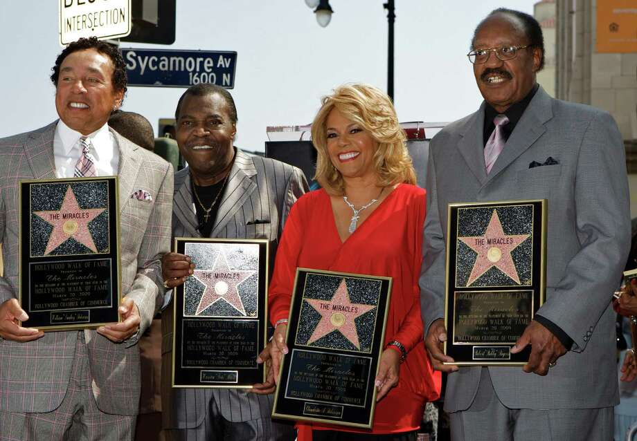 "FILE - In this March 20, 2009 file photo, members of the Motown group The Miracles, from left: William ""Smokey"" Robinson, Warren ""Pete"" Moore, Claudette Robinson, and Robert ""Bobby"" Rogers, are honored with a star on the Hollywood Walk of Fame in Los Angeles. Rogers, a founding member of the group and a collaborator with Smokey, has died. Motown Museum board member Allen Rawls said Rogers died Sunday, March 3, 2013, at his home. He was 73. (AP Photo/Damian Dovarganes, file) Photo: Damian Dovarganes"